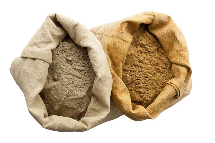 henna basma  powder isolated white background linen sack